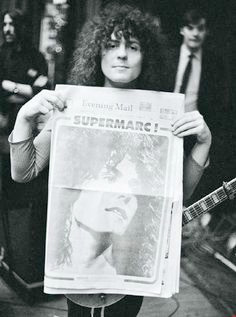 marc-holding-super-marc-newspaper